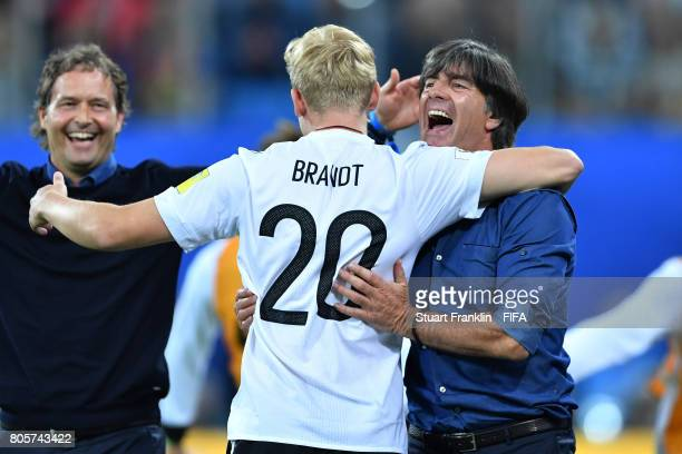 Joachim Loew coach of Germany celebrates victory with Julian Brandt of Germany after the FIFA Confederations Cup Russia 2017 Final between Chile and...