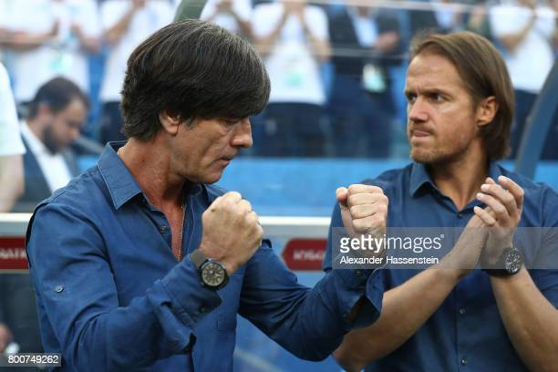 Joachim Loew coach of Germany gestures with assistant coach Thomas Schneider prior to the FIFA Confederations Cup Russia 2017 Group B match between...