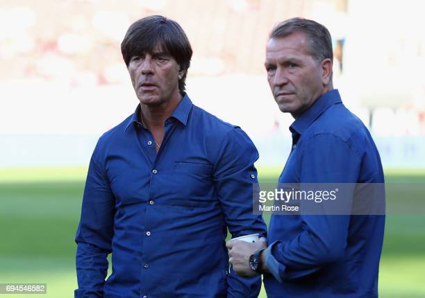 Joachim Loew coach of Germany speaks with Oliver Bierhoff Germany business manager prior to the FIFA 2018 World Cup Qualifier between Germany and San...