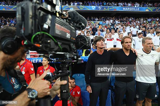 Joachim Loew head coach of Germany and his assistent coaches Thomas Schneider and Andreas Koepcke prior to the UEFA EURO 2016 semi final match...