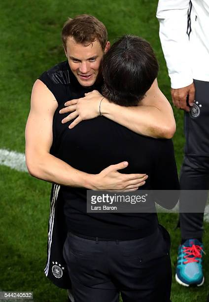 Joachim Loew head coach of Germany and Manuel Neuer celebrate their win through the penalty shootout during the UEFA EURO 2016 quarter final match...