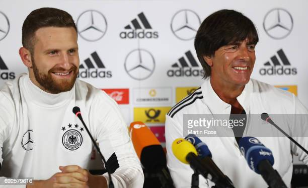 Joachim Loew head coach of Germany and Shkodran Mustafi smile during a Germany press conference ahead of their international friendly match against...