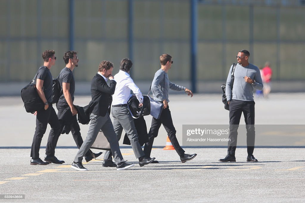 <a gi-track='captionPersonalityLinkClicked' href=/galleries/search?phrase=Joachim+Loew&family=editorial&specificpeople=215315 ng-click='$event.stopPropagation()'>Joachim Loew</a> (C), head coach of Germany arrives with the German national team at Lugano Airport on May 24, 2016 in Ascona, Switzerland.