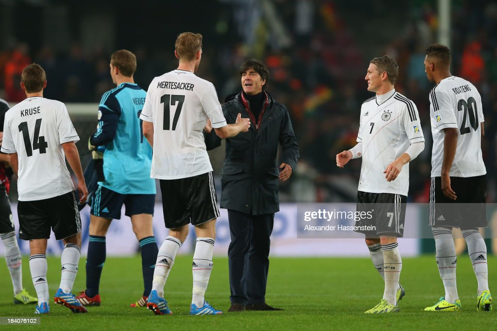 <a gi-track='captionPersonalityLinkClicked' href=/galleries/search?phrase=Joachim+Loew&family=editorial&specificpeople=215315 ng-click='$event.stopPropagation()'>Joachim Loew</a> (C), head coach of Germany celebrates victory with his palyers after the FIFA 2014 World Cup Qualifier Group C match between Germany and Republic of Ireland at Rhein-Energie-Stadion on October 11, 2013 in Cologne, Germany.