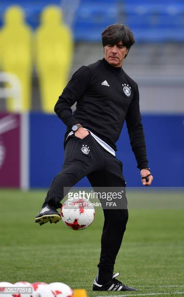 Joachim Loew head coach of Germany controls a ball during a training session of the German national football team on July 1 2017 in Saint Petersburg...