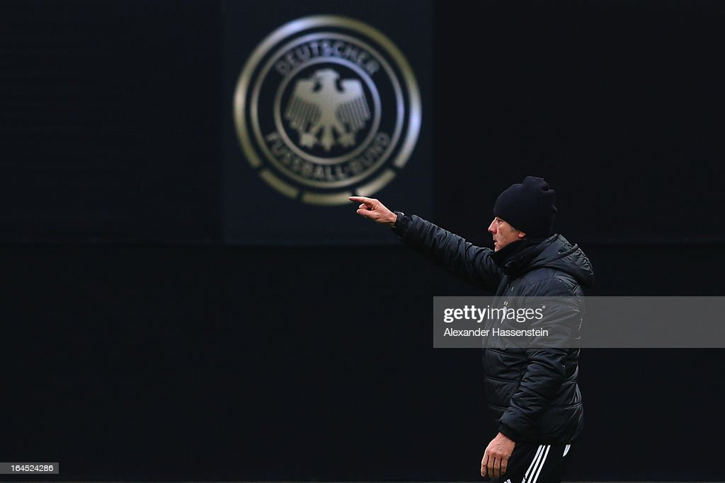 <a gi-track='captionPersonalityLinkClicked' href=/galleries/search?phrase=Joachim+Loew&family=editorial&specificpeople=215315 ng-click='$event.stopPropagation()'>Joachim Loew</a>, head coach of Germany gives instructions during a training session of the German national football team at Grundig-Stadion on March 24, 2013 in Nuremberg, Germany.
