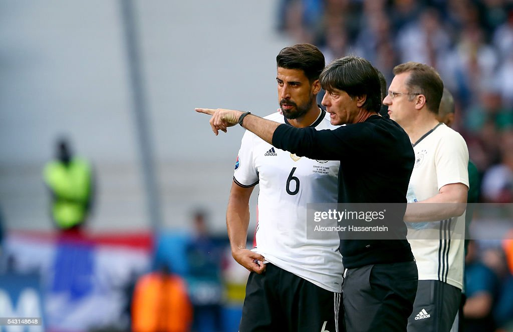 <a gi-track='captionPersonalityLinkClicked' href=/galleries/search?phrase=Joachim+Loew&family=editorial&specificpeople=215315 ng-click='$event.stopPropagation()'>Joachim Loew</a> (C) head coach of Germany instructs <a gi-track='captionPersonalityLinkClicked' href=/galleries/search?phrase=Sami+Khedira&family=editorial&specificpeople=2513712 ng-click='$event.stopPropagation()'>Sami Khedira</a> (L) during the UEFA EURO 2016 round of 16 match between Germany and Slovakia at Stade Pierre-Mauroy on June 26, 2016 in Lille, France.