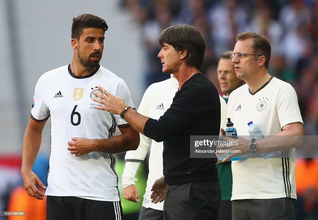 Joachim Loew (C) head coach of Germany instructs Sami Khedira (L) during the UEFA EURO 2016 round of 16 match between Germany and Slovakia at Stade Pierre-Mauroy on June 26, 2016 in Lille, France.