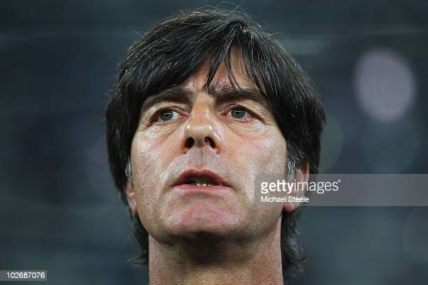 Joachim Loew head coach of Germany lines up for the national anthems prior to the 2010 FIFA World Cup South Africa Semi Final match between Germany...