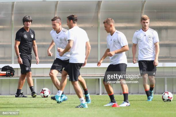 Joachim Loew head coach of Germany looks on during a training session of the German National team at RobertSchlienzStadion on August 30 2017 in...