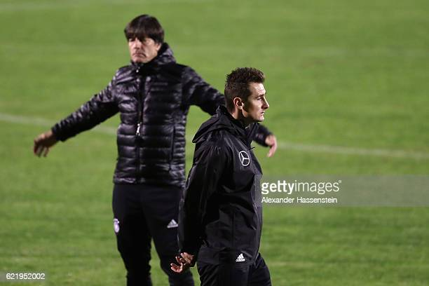 Joachim Loew head coach of Germany looks on with assistent coach Miroslav Klose during a training session of the German national team at Stadio di...