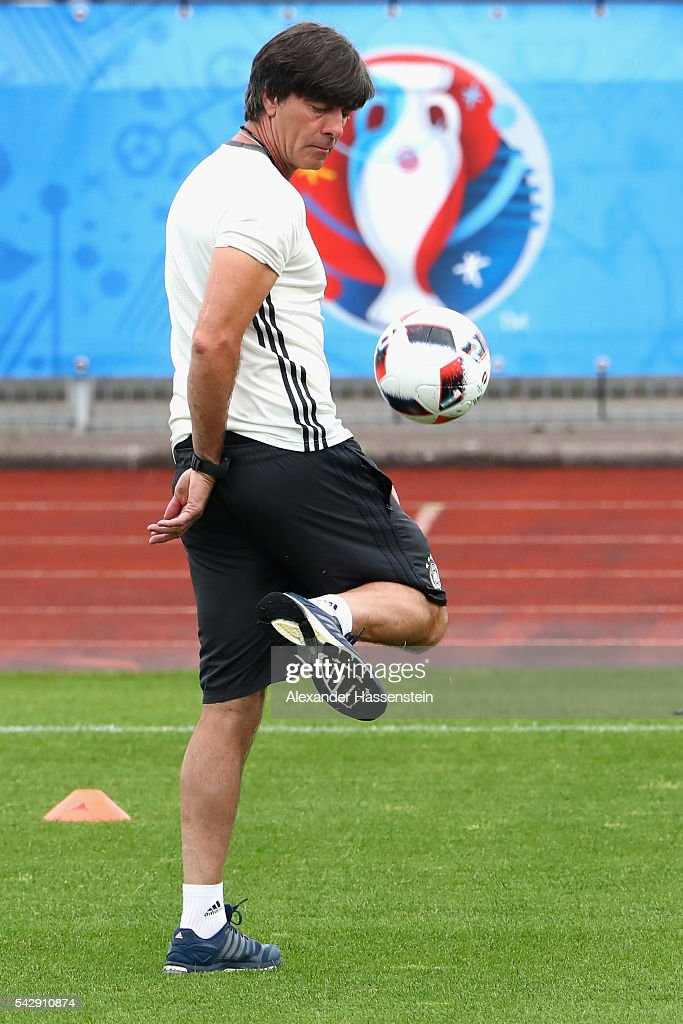 <a gi-track='captionPersonalityLinkClicked' href=/galleries/search?phrase=Joachim+Loew&family=editorial&specificpeople=215315 ng-click='$event.stopPropagation()'>Joachim Loew</a>, head coach of Germany plays with the ball during a Germany training session ahead of their Euro 2016 round of 16 match against Slovakia at Ermitage Evian on June 25, 2016 in Evian-les-Bains, France.