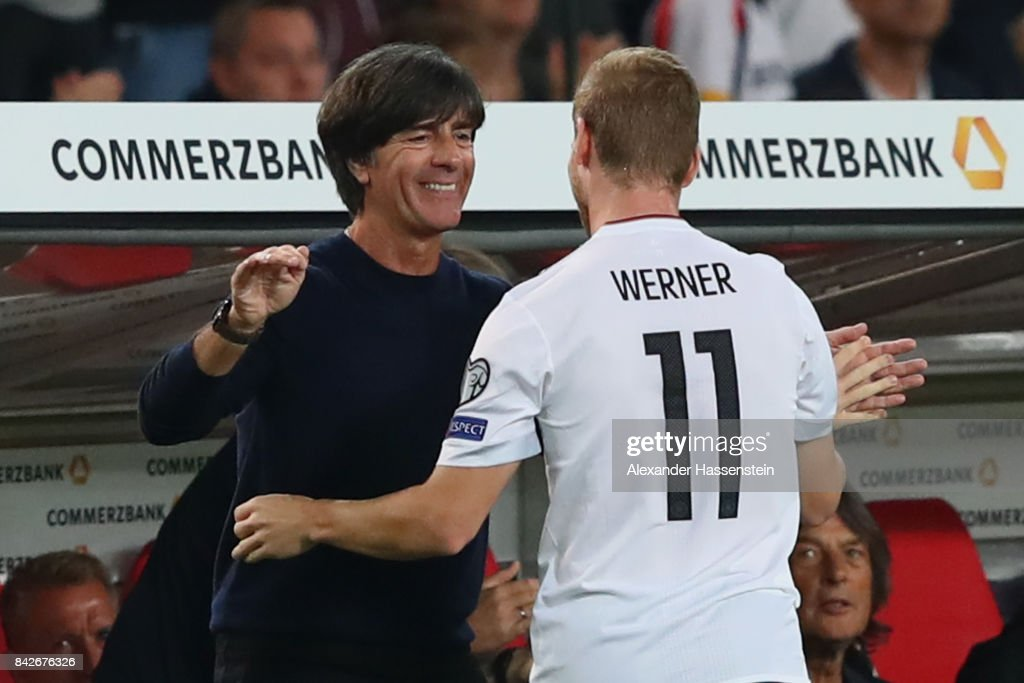 Joachim Loew, head coach of Germany reacts with his player Timo Werner during his substution at the FIFA 2018 World Cup Qualifier between Germany and Norway at Mercedes-Benz Arena on September 4, 2017 in Stuttgart, Baden-Wuerttemberg.
