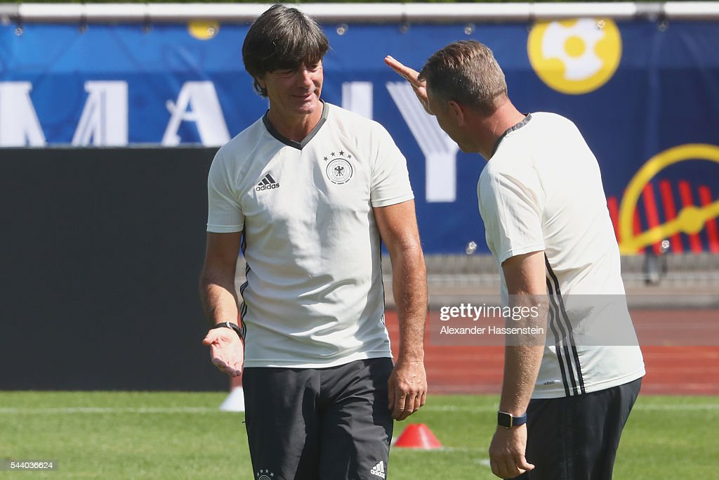 <a gi-track='captionPersonalityLinkClicked' href=/galleries/search?phrase=Joachim+Loew&family=editorial&specificpeople=215315 ng-click='$event.stopPropagation()'>Joachim Loew</a> (L), head coach of Germany shake hands with his assistent coach Andreas Koepcke to a Germany training session ahead of their Euro 2016 quarter final match against Italy at Ermitage Evian on July 01, 2016 in Evian-les-Bains, France.