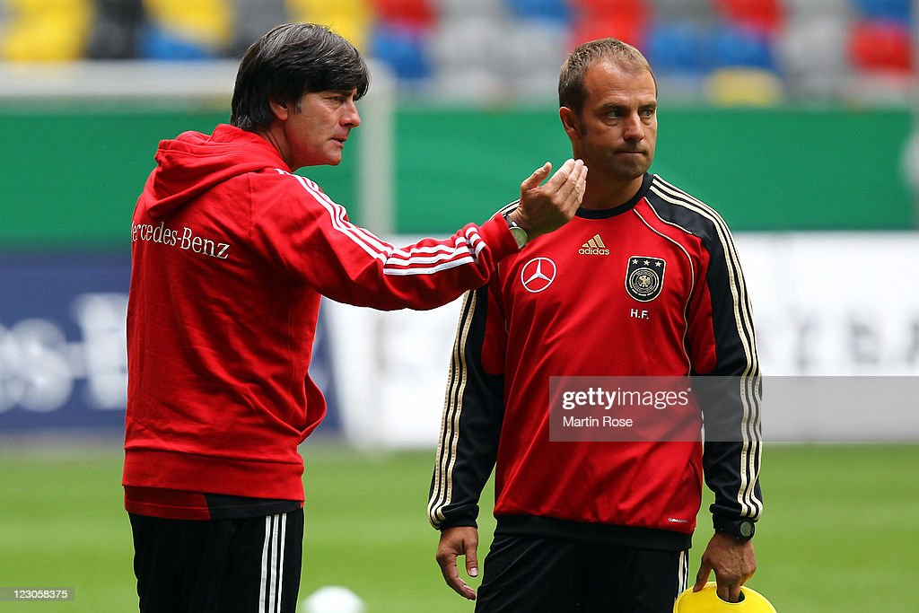 <a gi-track='captionPersonalityLinkClicked' href=/galleries/search?phrase=Joachim+Loew&family=editorial&specificpeople=215315 ng-click='$event.stopPropagation()'>Joachim Loew</a> (L), head coach of Germany speaks to assistant coach Hansi Flick during the German National Team training session at esprit Arena on August 30, 2011 in Duesseldorf, Germany.