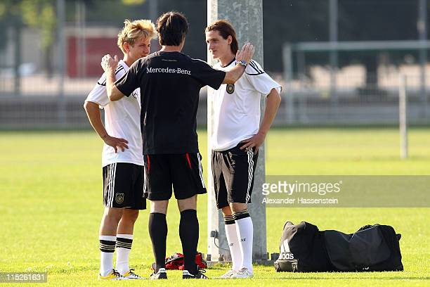 Joachim Loew head coach of Germany talks to his new players Lewis Holtby and Sebastian Rudy during a training session on June 5 2011 in Vienna Austria
