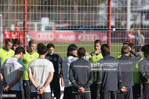 Joachim Loew head coach of Germany talks to his player prior to a training session whilst the team of FC Bayern Muenchen train on the training ground...