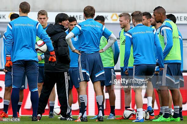 Joachim Loew head coach of Germany talks to his players during a training session of the German National team at Stadium Leipzig on October 10 2015...