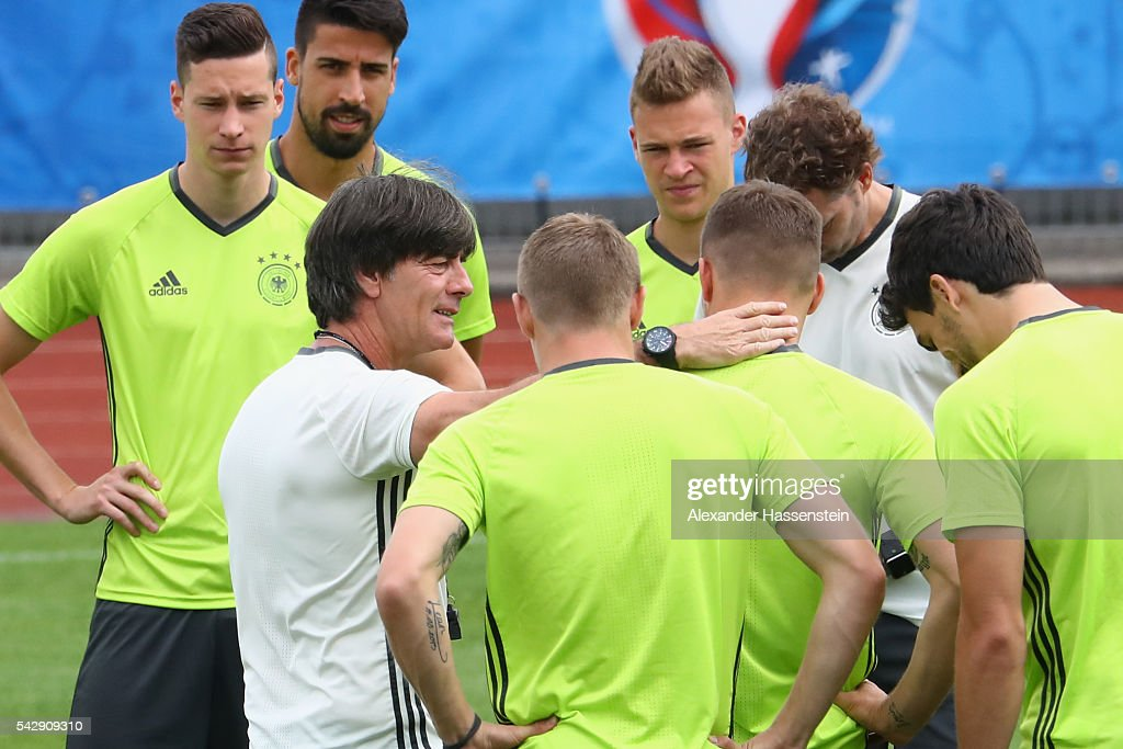 Joachim Loew, head coach of Germany talks to his players during a Germany training session ahead of their Euro 2016 round of 16 match against Slovakia at Ermitage Evian on June 25, 2016 in Evian-les-Bains, France.