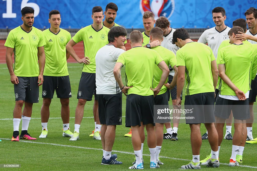 <a gi-track='captionPersonalityLinkClicked' href=/galleries/search?phrase=Joachim+Loew&family=editorial&specificpeople=215315 ng-click='$event.stopPropagation()'>Joachim Loew</a>, head coach of Germany talks to his players during a Germany training session ahead of their Euro 2016 round of 16 match against Slovakia at Ermitage Evian on June 25, 2016 in Evian-les-Bains, France.