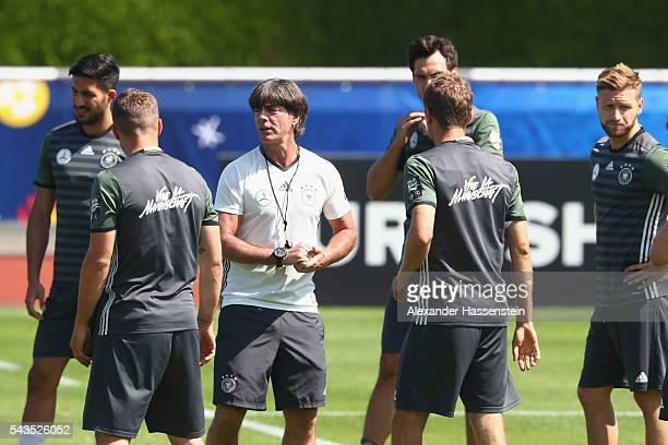 Joachim Loew head coach of Germany talks to his players during a Germany training session at Ermitage Evian on June 29 2016 in EvianlesBains France