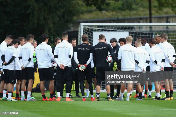 Joachim Loew head coach of Germany talks to his players during a team Germany training session at Kleine Kampfbahn Stadium on October 3 2017 in...