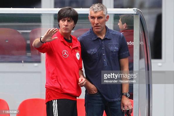 Joachim Loew head coach of Germany talks to Mirko Slomka head coach of Hannover 96 during a training session ahead of their UEFA EURO 2012 qualifying...