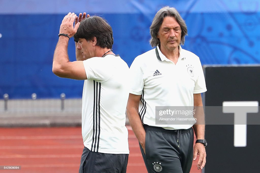 <a gi-track='captionPersonalityLinkClicked' href=/galleries/search?phrase=Joachim+Loew&family=editorial&specificpeople=215315 ng-click='$event.stopPropagation()'>Joachim Loew</a> head coach of Germany talks to team doctor Hans-Wilhelm Mueller-Wohlfahrt during a Germany training session ahead of their Euro 2016 round of 16 match against Slovakia at Ermitage Evian on June 25, 2016 in Evian-les-Bains, France.