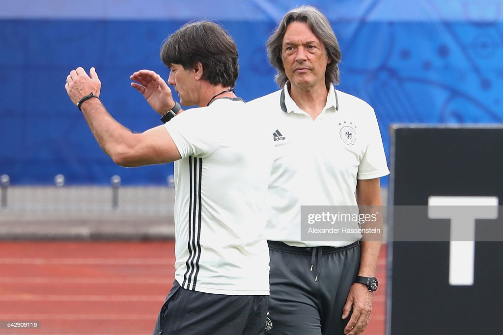 Joachim Loew head coach of Germany talks to team doctor Hans-Wilhelm Mueller-Wohlfahrt during a Germany training session ahead of their Euro 2016 round of 16 match against Slovakia at Ermitage Evian on June 25, 2016 in Evian-les-Bains, France.