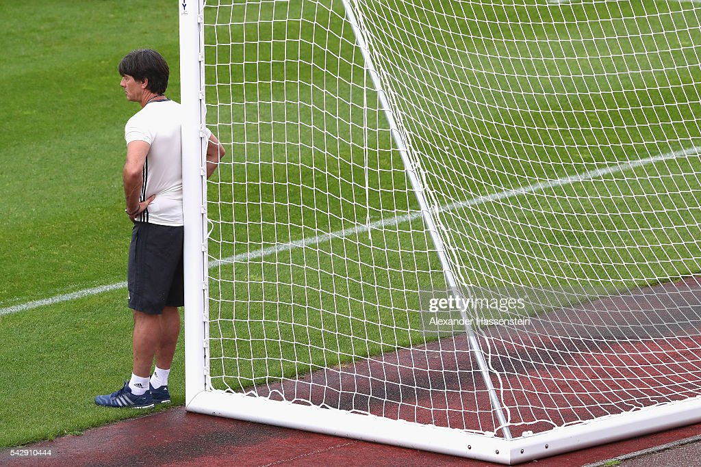 Joachim Loew head coach of Germany tlooks on during a Germany training session ahead of their Euro 2016 round of 16 match against Slovakia at Ermitage Evian on June 25, 2016 in Evian-les-Bains, France.