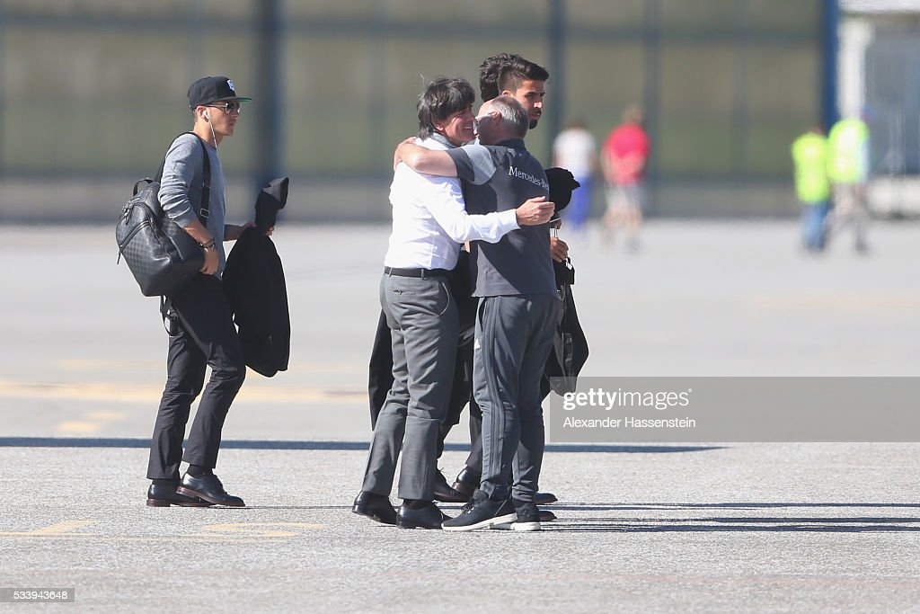 <a gi-track='captionPersonalityLinkClicked' href=/galleries/search?phrase=Joachim+Loew&family=editorial&specificpeople=215315 ng-click='$event.stopPropagation()'>Joachim Loew</a>, head coach of Germany welcomes team coach driver Wolfgang Fellner as thei arrives with the German national team at Lugano Airport on May 24, 2016 in Ascona, Switzerland.