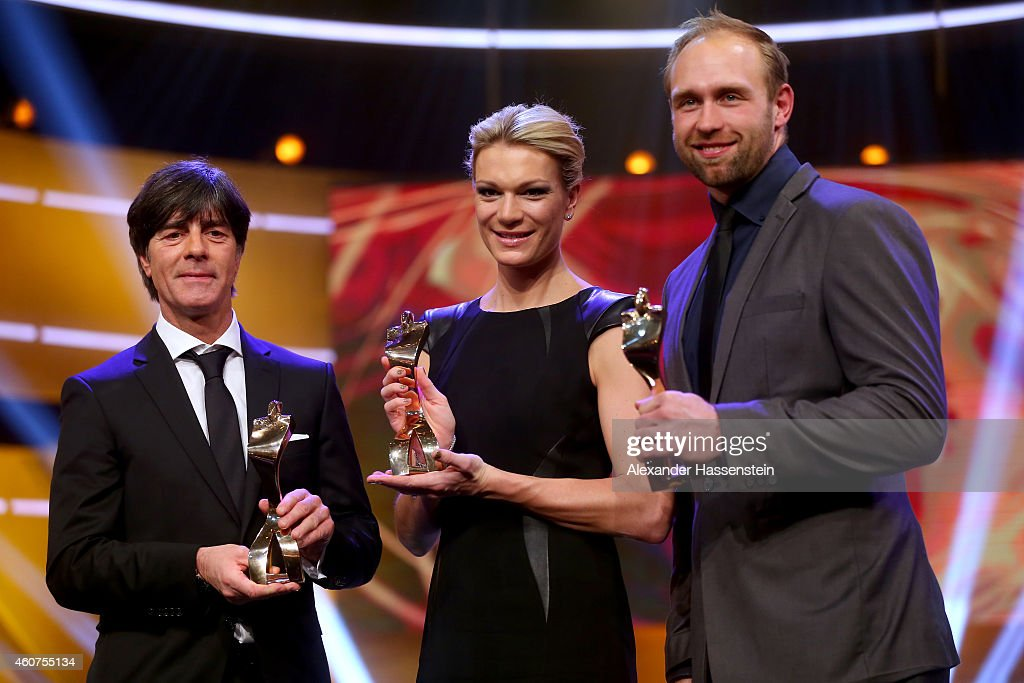 <a gi-track='captionPersonalityLinkClicked' href=/galleries/search?phrase=Joachim+Loew&family=editorial&specificpeople=215315 ng-click='$event.stopPropagation()'>Joachim Loew</a>, head coach of the German national football team, <a gi-track='captionPersonalityLinkClicked' href=/galleries/search?phrase=Maria+Hoefl-Riesch&family=editorial&specificpeople=7648886 ng-click='$event.stopPropagation()'>Maria Hoefl-Riesch</a> and <a gi-track='captionPersonalityLinkClicked' href=/galleries/search?phrase=Robert+Harting&family=editorial&specificpeople=4454412 ng-click='$event.stopPropagation()'>Robert Harting</a> pose with their Athlete of the Year awards after the Sportler des Jahres 2014 (German Athlete of the Year) gala at the Kurhaus Baden-Baden on December 21, 2014 in Baden-Baden, Germany.