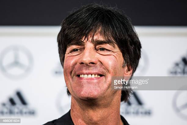 Joachim Loew head coach of the German national football team smiles during a press conference to announce the new contract of Joachim Loew at DFB...