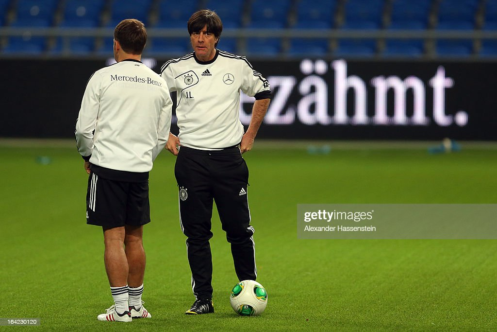 Joachim Loew, head coach of the German national football team talks to his assistent coach Hansi Flick (L) during a training session at Astana arena on March 21, 2013 in Astana, Kazakhstan.