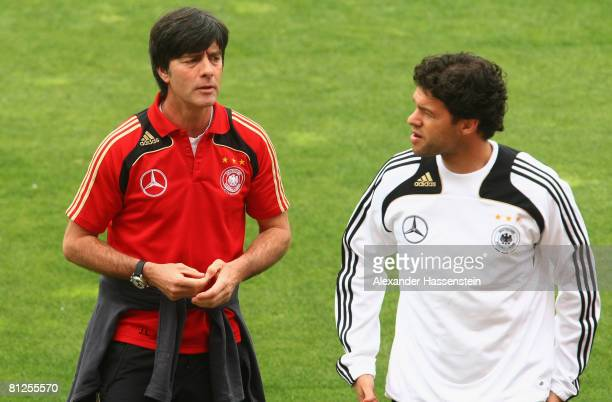 Joachim Loew head coach of the German national football team talks to player Michael Ballack during a Germany training session at the Son Moix...