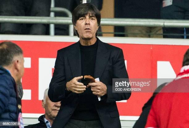 Joachim Loew head coach of the German national football team watches the UEFA Champions League 1st leg quarterfinal football match FC Bayern Munich v...