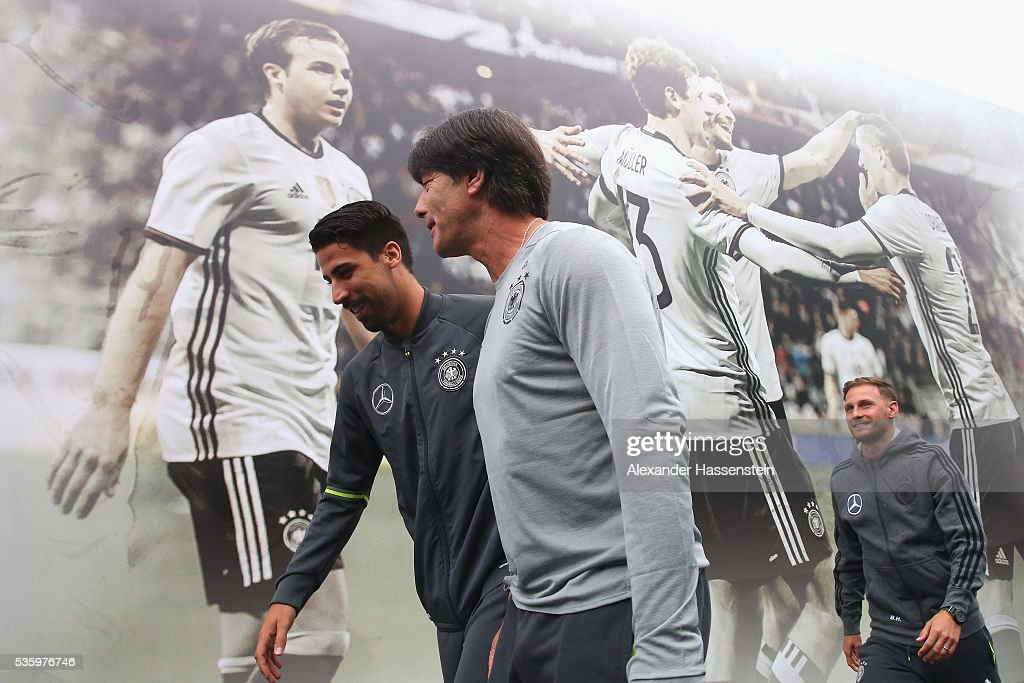Joachim Loew (C), head coach of the German national team arrives with his player <a gi-track='captionPersonalityLinkClicked' href=/galleries/search?phrase=Sami+Khedira&family=editorial&specificpeople=2513712 ng-click='$event.stopPropagation()'>Sami Khedira</a> (L) and Bendeikt Hoewedes for a press conference on day 8 of the German national team trainings camp on May 31, 2016 in Ascona, Switzerland.
