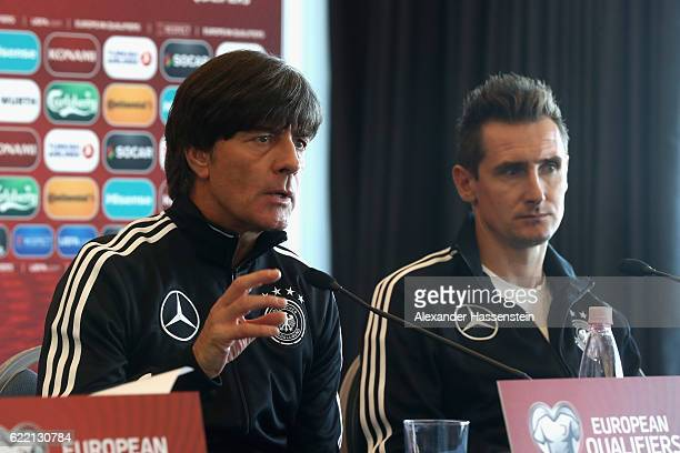 Joachim Loew head coach of the German national team attends with assistent coiach Miroslav Klose a press conference of the German national team ahead...