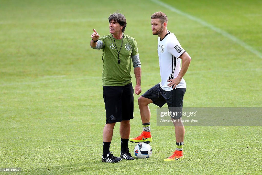 <a gi-track='captionPersonalityLinkClicked' href=/galleries/search?phrase=Joachim+Loew&family=editorial&specificpeople=215315 ng-click='$event.stopPropagation()'>Joachim Loew</a>, head coach of the German national team gives instructions to his player <a gi-track='captionPersonalityLinkClicked' href=/galleries/search?phrase=Shkodran+Mustafi&family=editorial&specificpeople=5006425 ng-click='$event.stopPropagation()'>Shkodran Mustafi</a> during a training session at Stadio communale on day 8 of the German national team trainings camp on May 31, 2016 in Ascona, Switzerland.