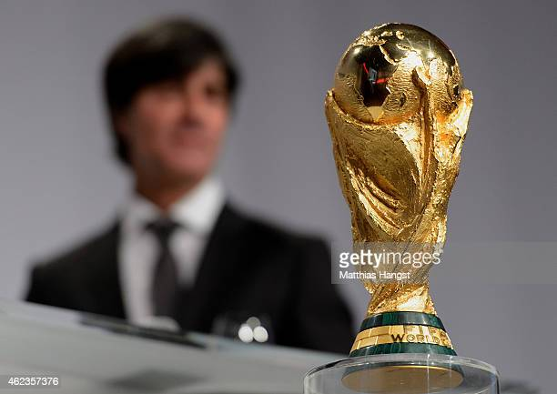 Joachim Loew head coach of the German national team seen on the podium with the World Cup Trophy during the DFL New Year's Reception 'Anstoss 2015'...