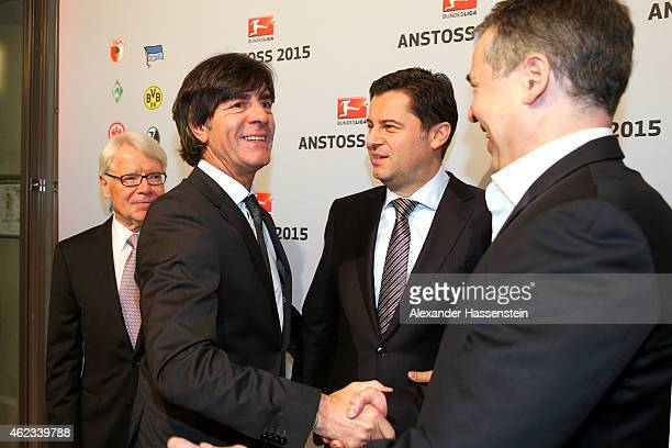 Joachim Loew head coach of the German national team talks to Dr Reinhard Rauball President of Deutsche Fussball Liga DFL Christian Seifert CEO of...