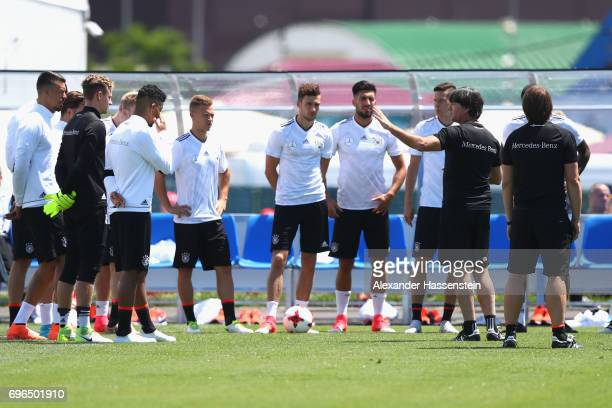 Joachim Loew head coach of the German national team talks to his players during a training session at Park Arena training ground on June 16 2017 in...