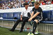 Joachim Loew head coach of the German national team talks to his player Bastian Schweinsteiger prior to the international friendly match between...