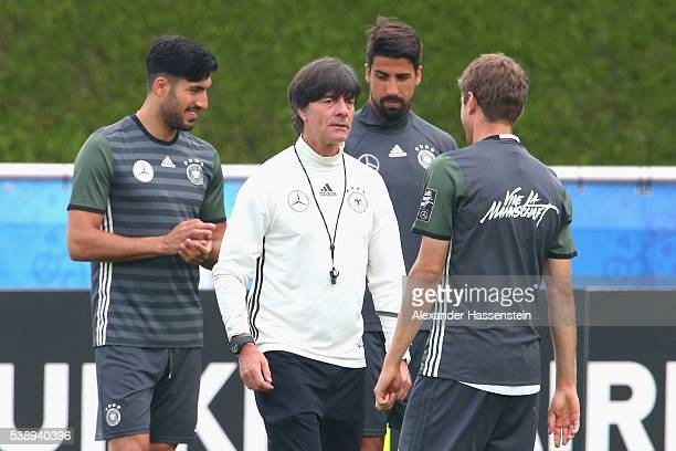 Joachim Loew head coach of the German national team talks to his player Thomas Mueller during a Germany training session ahead of the UEFA EURO 2016...
