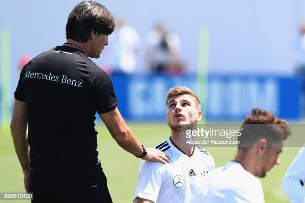 Joachim Loew head coach of the German national team talks to his player Timo Werner during a training session at Park Arena training ground on June...
