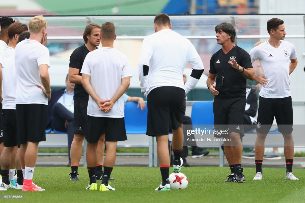 Joachim Loew (2nd R), head coach of the German national team talks to his players prior to a team Germany training session at Park Arena training ground on June 18, 2017 in Sochi, Russia. Germany will play against Australia on their Group B FIFA Confederation Cup Russia 2017 match on June 19, 2017 in Sochi, Russia.