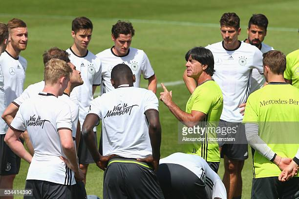 Joachim Loew head coach of the Germany national team talks to his players during a training session at stadio communale on day 3 of the German...