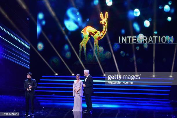 Joachim Loew Helene Fischer and Winfried Kretschmann on stage during the Bambi Awards 2016 show at Stage Theater on November 17 2016 in Berlin Germany