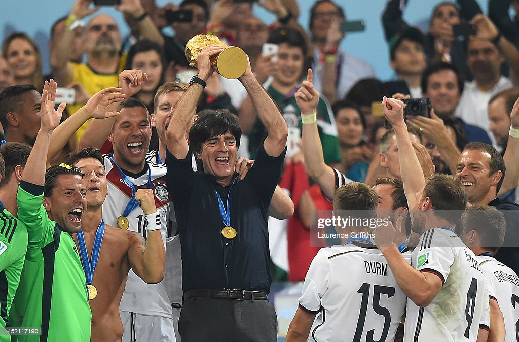 <a gi-track='captionPersonalityLinkClicked' href=/galleries/search?phrase=Joachim+Loew&family=editorial&specificpeople=215315 ng-click='$event.stopPropagation()'>Joachim Loew</a> of Germany lifts the World Cup trophy with his team after defeating Argentina 1-0 in extra time during the 2014 FIFA World Cup Brazil Final match between Germany and Argentinaat Maracana on July 13, 2014 in Rio de Janeiro, Brazil.