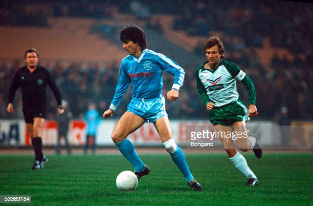 Joachim Loew of Karlsruhe and Benno Moehlmann of Bremen fight for a ball during the Bundesliga match SV Werder Bremen against Karlsruher SC at the...